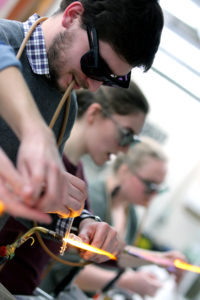 Students in a glass blowing class