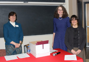 Faculty and staff, set up the ceremony, reception and poster session to honor student excellence.
