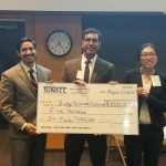 Left to right: Jonathan Valdez, Munish Chhabra, and Jennifer Yao stand with their third place check from the Tufts New England Case Competition. Alex Harwig was unable to attend the presentation but helped the team prepare for the contest.